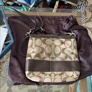 Coach purse and comes with bag to hold